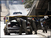 Police investigate bomb-making material in a car near Mr Thaksin's home on 24 August
