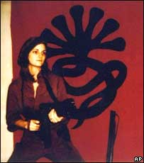 Patty Hearst so identified with her kidnappers that she helped them rob a bank