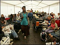 Passengers waiting to check-in at Heathrow on August 15