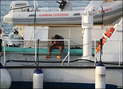 Would-be illegal immigrant on deck of Italy Navy ship in Lampedusa Port, south of Sicily