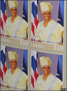 Postage stamps displaying Liberian President Ellen Johnson-Sirleaf's picture during a ceremony marking their reintroduction after almost two decades with no postal system