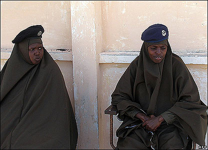 Hijab clad Somali policewomen guard inside the premises of the sea port of Mogadishu during a reopening ceremony