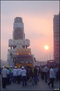 Sunrise over Cairo as the statue of King Ramses II continues its roll through the city