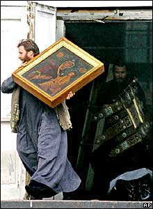 People carrying icons out of church door