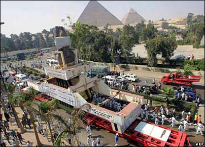 The statue passing the Giza pyramids as it heads towards its new home