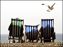 Sunbathers on deckchairs