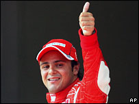 Ferrari's Felipe Massa celebrates taking pole