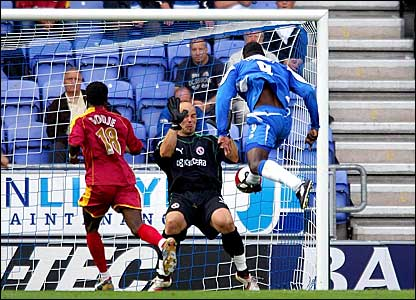Emile Heskey (right) scores for Wigan against Reading