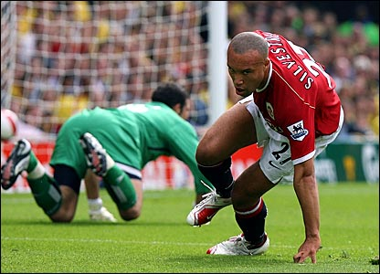 Manchester United's Mikael Silvestre turns away to celebrate after scoring against Watford