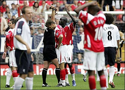 Hermann Hreidarsson (centre) is shown the red card by referee Mike Dean