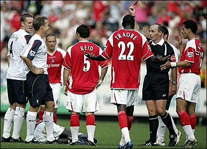 Bolton's Kevin Davies (second left) reacts after being shown the red card