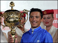 Frankie Dettori with his trophy after winning the six million dollar Dubai World Cup