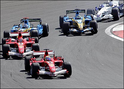 Felipe Massa leads into turn one from Michael Schumacher and Fernando Alonso with Giancarlo Fisichella (second right) in fourth