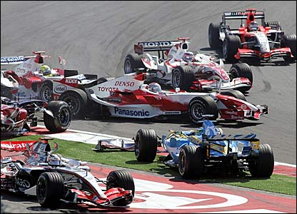 Giancarlo Fisichella (centre) causes chaos with his spin at turn one