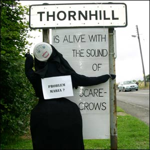 Scarecrow at road sign (picture by Duncan Kirkhope)