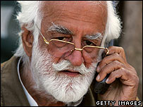 Nawab Akbar Bugti speaking on a satellite phone in Balochistan in January 2006