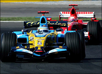 Fernando Alonso holds off Michael Schumacher