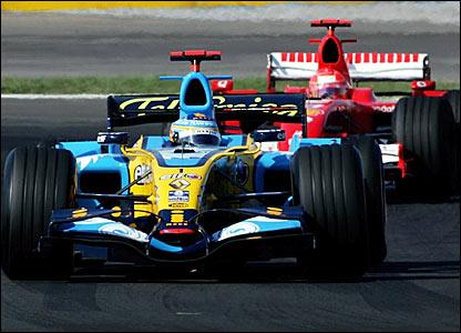 Fernando Alonso holds off Michael Schumacher