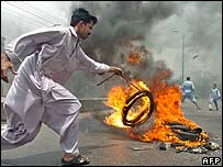 Man sets tyre on fire in Karachi, Pakistan, on Sunday