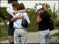 Family members of the plane crash victims comfort each other, Lexington, Kentucky