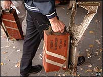 The cockpit voice recorder and data recorder from Comair flight 5191 are carried in to NTSB headquarters in Washington DC for analysis