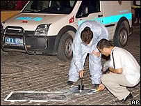 Turkish police forensic officers examine the blast site