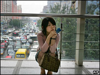 A woman waits for the subway at a station in Beijing