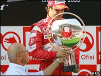 Mehmet Ali Talat hands the trophy to Brazilian Ferrari driver Felipe Massa at the Formula One Turkish Grand Prix