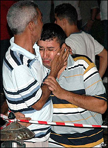 A man is comforted following the blasts in Marmaris