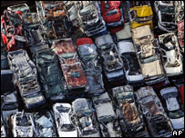 Stacks of cars in scrap yards in New Orleans, a year on from Hurricane Katrina