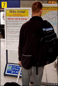 A passenger reads signs on display at Waterloo station