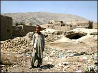 Boy stands in ruins of old Kabul