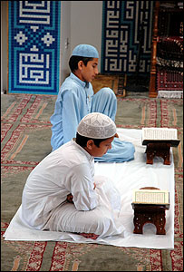 Boys praying at a mosque in New York