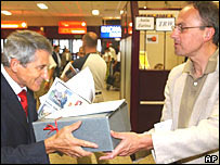 Neal Pease (right) presents a box containing letters dating back to the 13th Century to Wladyslaw Stepniak
