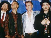 U2 in 1988, collecting a Grammy award for The Joshua Tree