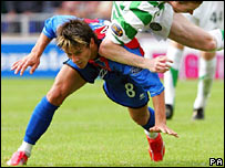 Caley Thistle's Ian Black challenges Celtic's Stephen Pearson