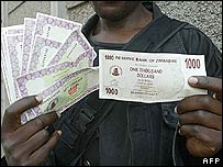 zimbabwean displays a new banknote r alongside the phased out angelina