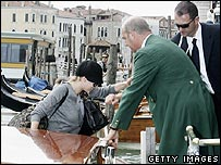 Scarlett Johansson (l) arrives in Venice