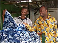 Philip Adu-Gyamf (left) at ATL's textiles factory