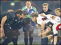 New Zealand and England prepare to engage in a scrum