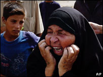 A woman cries after identifying her son as one of those killed in the Hilla bombing