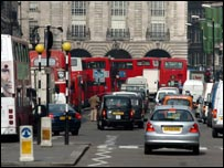 Cars, buses and taxis on a London road