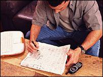 A man reading a job advert