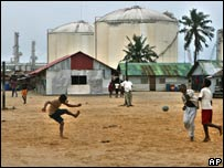 Children and oil tanks at Bonny Island, Nigeria