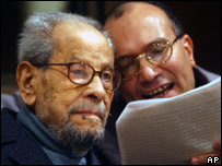 Naguib Mahfouz, left, listens to Egyptian journalist Ibrahim Abdel Aziz in 2004