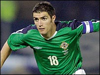 Aaron Hughes leads Northern Ireland against Iceland