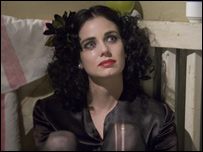 Mia Kirshner as Beth Short, the Black Dahlia