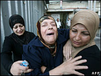 Fadi Khafisha's mother (centre) grieves at death of her son