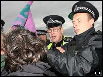 Police restrain a protester