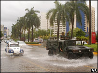 A Mexican army truck drives down the main avenue of the resort of Acapulco on Wednesday 30 August